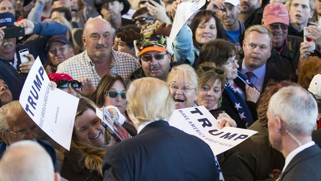 Supporters try to get a glimpse of Republican presidential candidate Donald Trump during his rally in Mesa on Wednesday.