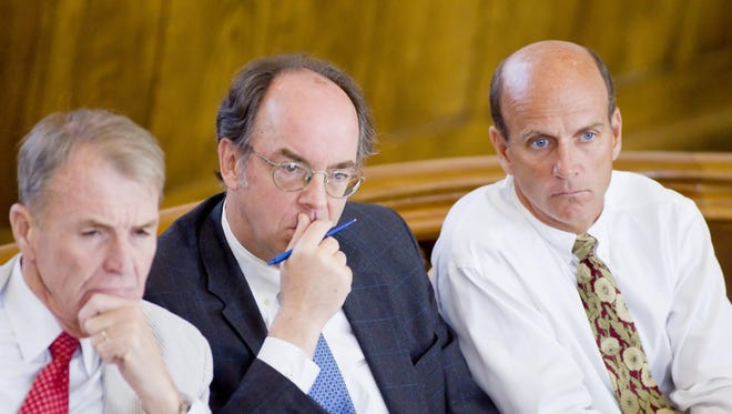 From left defense attorneys Terence Kindlon, William Easton and defendant Calvin Harris listen in 2009 to the prosecution ask New York State Police Senior Investigator Leslie Hyman if there are any records of calls from Calvin Harris to Michele Harris' cell phone on Sept 12, 2001.