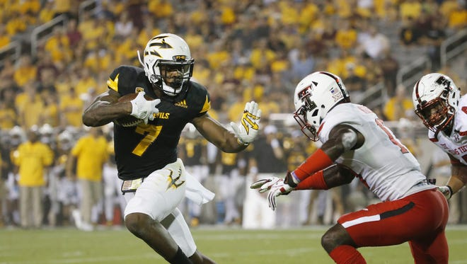 ASU running back Kalen Ballage turns the corner on Texas Tech defensive back Thierry Nguema (17) during a touchdown run during the second quarter at Sun Devil Stadium in Tempe, Ariz. September 10, 2016.