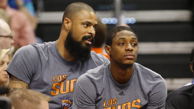 Suns center Tyson Chandler (left) and guard Brandon Knight watch during a against the Celtics on March 5.