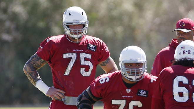 Arizona Cardinals offensive guard Alex Boone (75) watches guard Mike Iupati (76) performs a drill during practice in Tempe, Ariz. September 20, 2017.