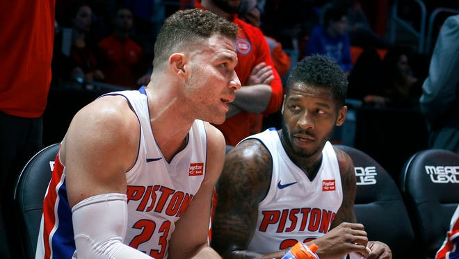 Detroit Pistons forward Blake Griffin, left, talks with guard Dwight Buycks during the second half against the Memphis Grizzlies on Thursday, Feb. 1, 2018 in Detroit.