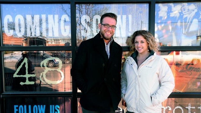 Marketing director Jake VanAtta and managing partner and director of operations Lisa Manno outside The Beer Grotto, which is under construction in the Stadium District in downtown Lansing.