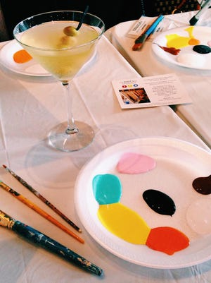 A dirty martini and Eat Paint Love art supplies are shown at Tomáš in Wappingers Falls.