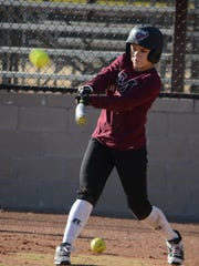 McMurry outfielder Krysta Winegeart, a Haskell graduate, hits a ball during a practice Friday, Jan. 19, 2018, at Red Bud Park.