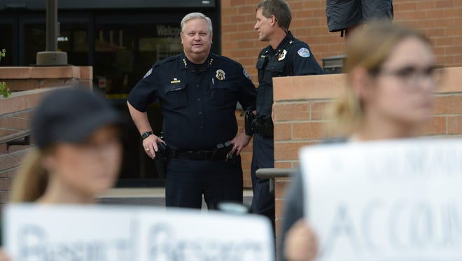 Fort Collins Police Chief John Hutto watches a rally Òfor police accountabilityÓ following the viral arrest video of CSU student Michaella Surat outside City Hall on Tuesday, April 18, 2017.