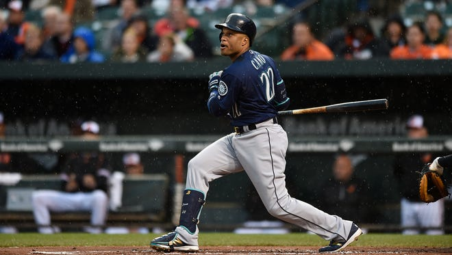 Seattle Mariners Robinson Cano at bat against the Baltimore Orioles in a baseball game, Wednesday, May 18, 2016, in Baltimore. (AP Photo/Gail Burton)