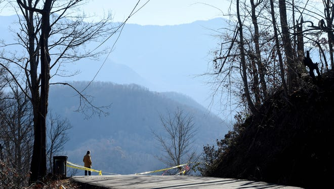 Gatlinburg Mayor Mike Werner looks out over the view of the ruins of his home of more than 20 years atop Greystone Heights Road on Thursday, Dec. 22, 2016, in downtown Gatlinburg.
