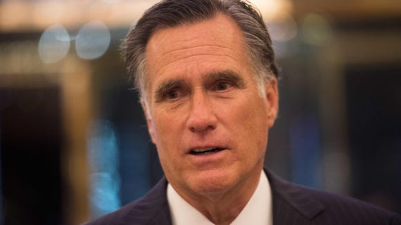 Mitt Romney speaks to the media after meeting with
