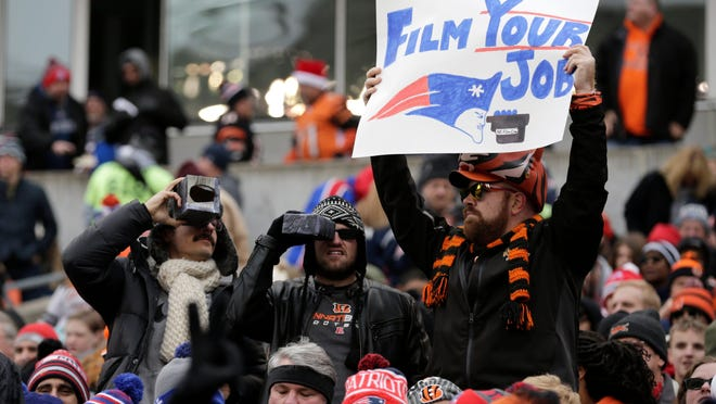 Fans mock the latest New England Patriots scandal during the second quarter of the NFL Week 15 game between the Cincinnati Bengals and the New England Patriots at Paul Brown Stadium in Cincinnati on Dec. 15, 2019.