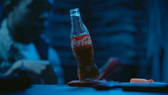"A Super Bowl ad for Coca-Cola features Coke being ""poured into the Internet.""  The ad is titled, ""Make it Happy."""