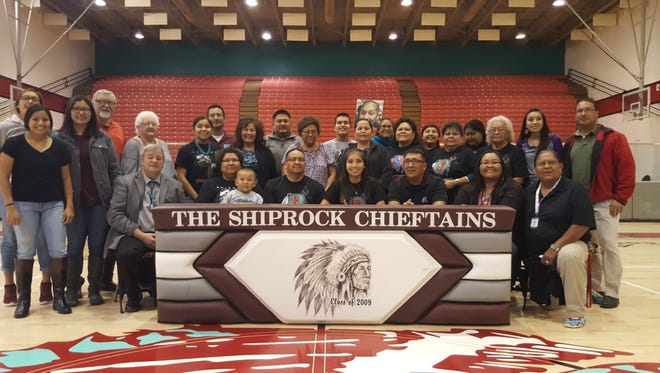 Tanisha Begay, center, signs a national letter of intent to play basketball for the Fort Lewis College Lady Skyhawks on Tuesday at the Chieftain Pit in Shiprock.