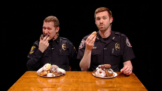Ames police Offcer Eric Snyder (left) and Iowa State University police Officer Anthony Greiter star in a new video using doughnuts that help promotes respect.