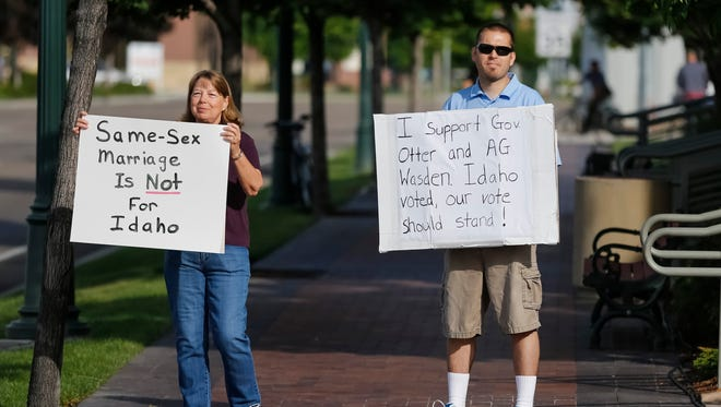 Sue and James Barclay are among a handful of protesters of a gay marriage celebration at the Ada County Courthouse in Boise, Idaho, on Friday.