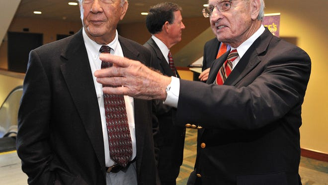 Pat Dye, left, is greeted by retired Georgia coach Vince Dooley on Friday, Oct. 31, 2014, in Jacksonville, Fla., a day before the college football game between Florida and Georgia.