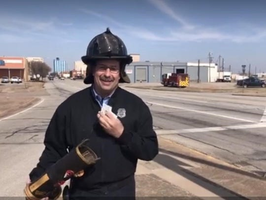 A Wichita Falls firefighter greeted drivers at a downtown