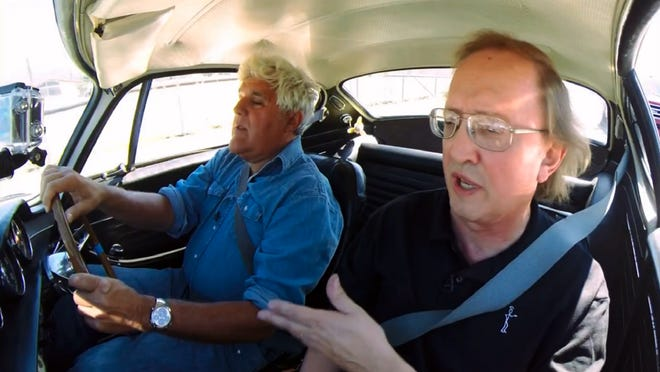 Jay Leno talks with Bill Krzastek while driving Krzastek's 1967 Volvo P1800. This image is from a clip during Jay Leno's Garage, a web broadcast about cars. The show aired Sept. 15.