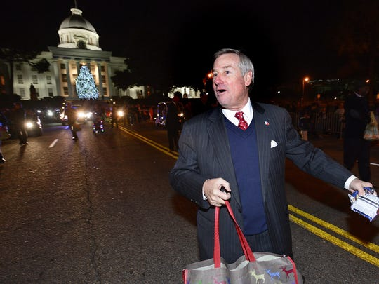 Montgomery Mayor Todd Strange throws treats as he walks in the Capitol City Christmas Parade  on Thursday evening December 19, 2013 in downtown Montgomery, Ala. (Mickey Welsh, Montgomery Advertiser)