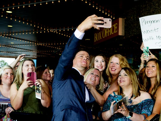 Channing Tatum takes a selfie with fans during the Regal Entertainment Group's 2017 red-carpet fundraiser benefiting Variety of East Tennessee at Regal Pinnacle Stadium 18 in Knoxville, Tennessee on Wednesday, August 9, 2017.Variety ChildrenÕs Charity of Eastern Tennessee helps children with disabilities or who are at risk. This year's event featured a visit by actor Channing Tatum.