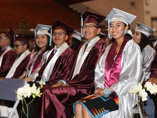 Shiprock High School graduates Chrishannon Keams, left,