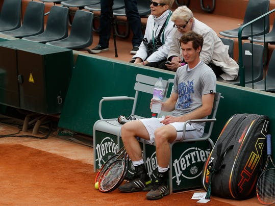 Britain's Andy Murray sits during a training session for the French Open tennis tournament, at the Roland Garros stadium in Paris, Friday, May 23, 2014. The French Open tennis tournament starts Sunday. (AP Photo/Michel Euler)