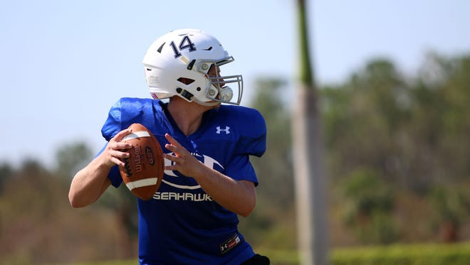 Richard Reisinger runs through quarterback drills during Community School's first practice back after Hurricane Irma shut down schools and cancelled games for weeks. The Seahawks are slated to be one of four area teams to play on Friday night when they face Moore Haven in a conference game.