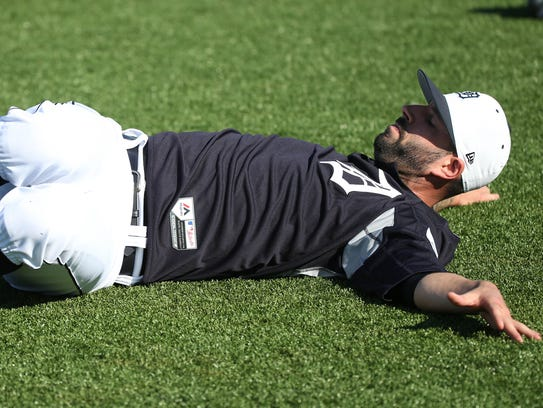 Tigers pitcher Mike Fiers stretches before spring training