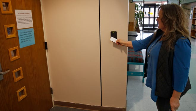 Donna Clifton, the city of Bloomfield's human resources analyst and compliance manager, demonstrates the new keyless entry system at the Bloomfield Fitness Center, located inside the city's Cultural Complex, on Friday.
