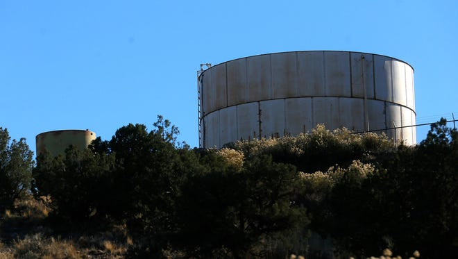 Water tanks on a hill in the Harvest Gold subdivision are pictured Nov. 7.