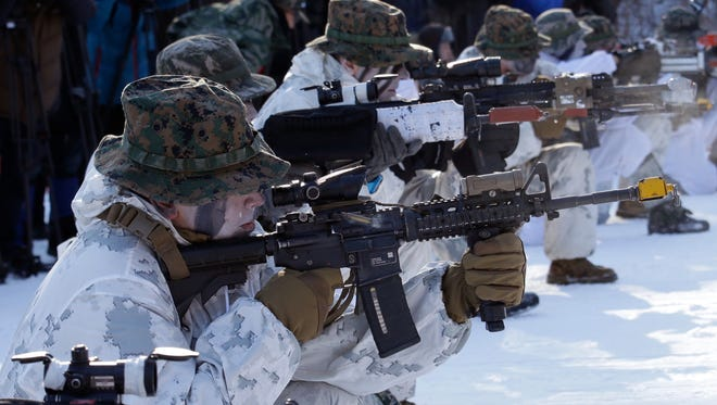 South Korean and U.S. Marines from III Marine Expeditionary Force from Okinawa, Japan, fire their machine guns during their joint military winter exercise in Pyeongchang, South Korea.
