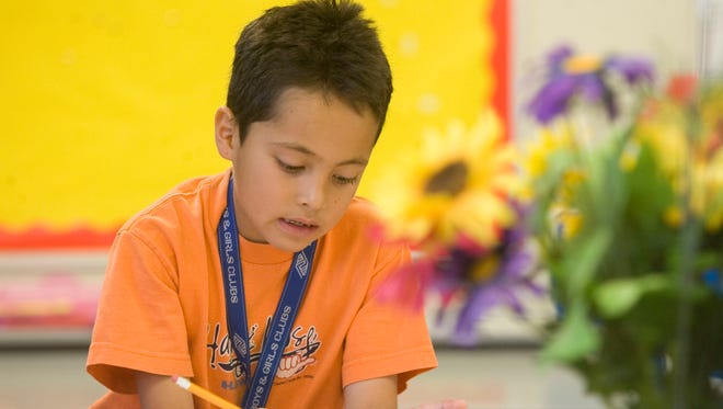Alan Mendiola , 7, draws during a Boys and Girls Club summer camp in 2010 at the Paiute Neighborhood Center in Scottsdale. The Boys and Girls Club was one of several recipients of funds from Scottsdale for the upcoming fiscal year.