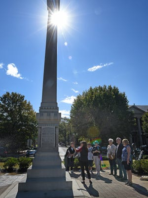 Alicia Marshall leads a group of tourists in at walking tour of downtown Franklin that includes a stop at the statue at the center of the town square on Main Street. Franklin is frequently featured on lists highlighting the best places to live, work or visit, and scenic Main Street is one of the major reasons for that Wednesday Oct. 12, 2016, in Franklin, Tenn.