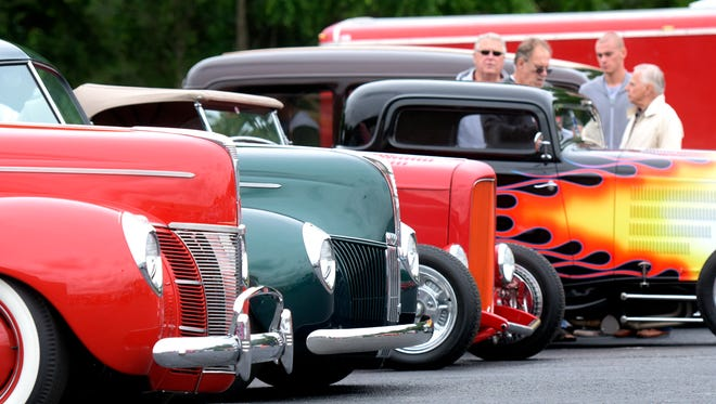 Street rods and a crowd gathers outside the Wyndham Garden Hotel where registration for the 42nd Annual Street Rod Nationals East took place Thursday, June 4, 2015. A kick-off party for the event is scheduled there at 7:30 p.m. Spectator admission to the event at the York Fairgrounds is 8 a.m. Friday. Bill Kalina - bkalina@yorkdispatch.com