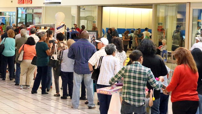 Voters form a long line Monday along the Bassett Place concourse to cast ballots during the first day of early voting for the Nov. 8 general election. It was the busiest early voting location Monday in El Paso, with 1,392 votes being cast, election officials said.