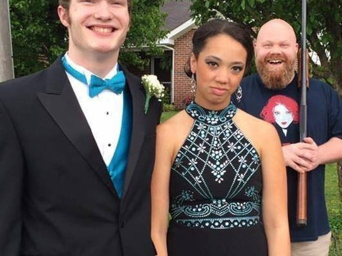 Caleb Underwood and Briana Wood posed for prom photos with Wood's dad, Luke, smiling in the background. Underwood and Wood attended Maryville High School's prom.