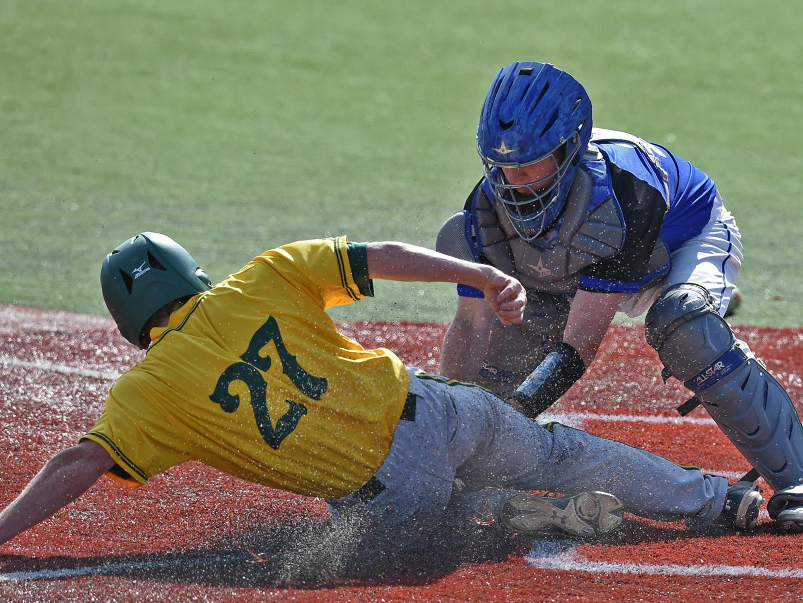 Bishop Manogue's Chase McAninch is tagged out at home plate by Carson's Kyle Krebs during the Northern Division I Region tournament at Peccole Park on Thursday.