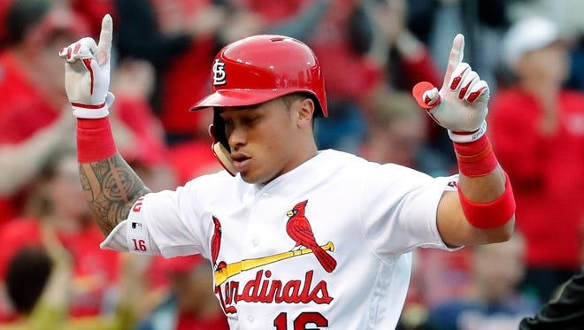 St. Louis Cardinals' Kolten Wong celebrates after hitting a solo home run during the third inning of a baseball game against the Pittsburgh Pirates, Monday, April 17, 2017, in St. Louis. (AP Photo/Jeff Roberson)