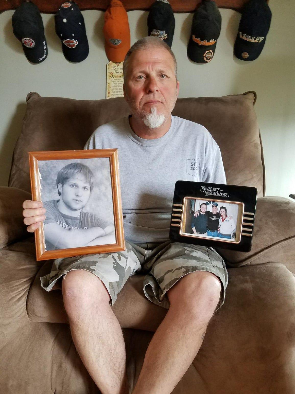 Billy Guysinger holds photos of his son Chase Guysinger