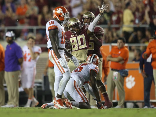 FSU's Nyqwan Murray signals his own first down after making a catch over Clemson's Cordrea Tankersley during their game at Doak Campbell Stadium.