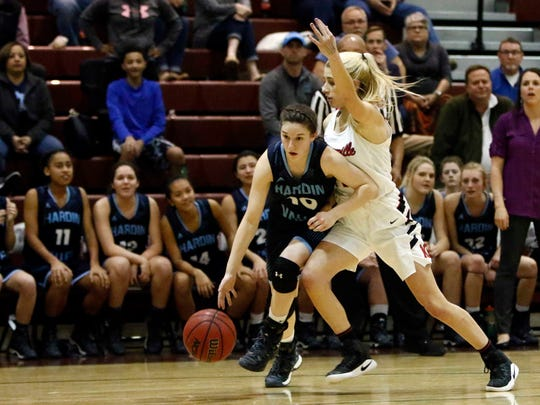 Hardin Valley's Lizzie Davis drives as she's defended by Maryville's Abby Anderson during the semifinals of the Region 2-AAA girls tournament game Monday, Feb. 27, 2017.