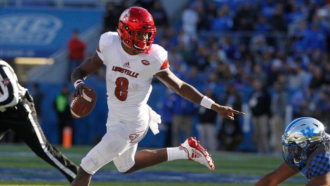Louisville Cardinals quarterback Lamar Jackson (8) runs the ball against Kentucky Wildcats.