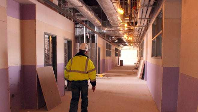 Herb Borden, Executive Director of Support Services for the Deming Public Schools, walks through a nearly completed section of the new Deming High School. Borden will also oversee the construction of the new intermediate school which will replace the existing school built in 1947.