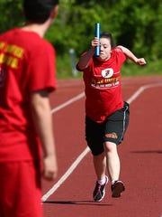 Mount Olive's Gabriella Parisi is ready to hand off to Matt Montello during the 4x200 at the NJAC Unified track and field meet at Jefferson Township High School . May 24, 2018. Randolph, NJ