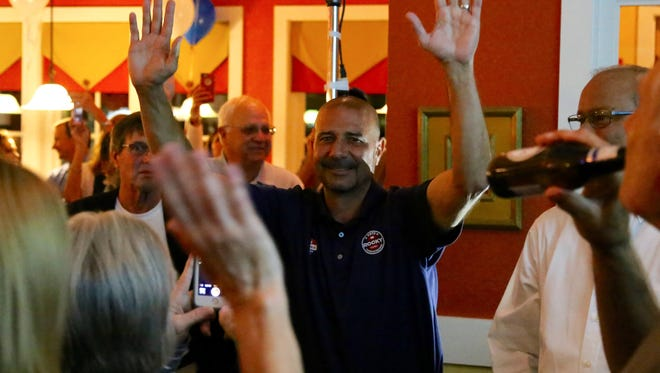 Rocky Hanna celebrates his victory at his election night party at the Egg Cafe on Tuesday, November 8, 2016.