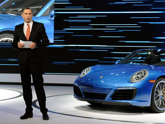 Klaus Zellmer, CEO of Porsche Cars North America, shows off a 911 sports cars at a past Los Angeles Auto Show.
