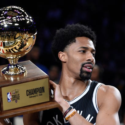Brooklyn Nets' Spencer Dinwiddie holds up his trophy