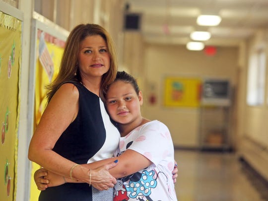 Anna Lisa Negro with her daughter Isabella, 10, at School 30 in Yonkers Sept. 10, 2015. Due the constant budget crisis in the school district, Negro, a former PTA president at the school 30, has removed her older child from the public schools. She and her husband are now deciding whether or not to keep Isabella, a fifth-grader, in the Yonkers public schools or to send her to a Catholic school.