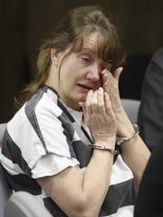 Cheryl McCafferty wipes a tear as testimony concerned