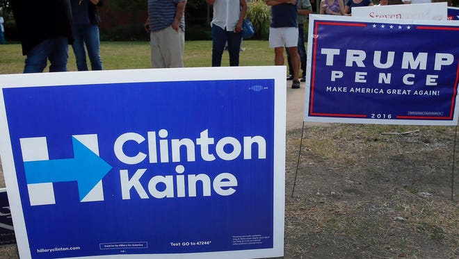 Signs representing both candidates are displayed as election day nears.