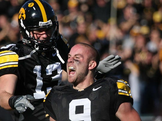 Former Iowa standout Tyler Sash, right, was found dead in September at age 27.
